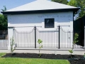 Wrought iron pool fence against the Georgian style poolhouse at Walkerville