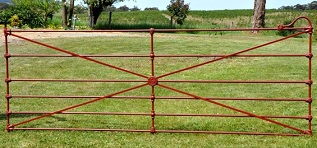 Federation era cast jointed gate was made with ornamental castings and round centrepiece from an original Sunshine McKay or Simpson farm gate