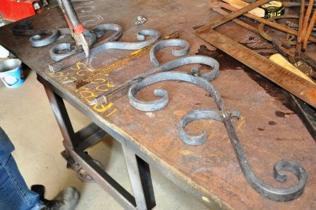 Laying out the scrolls for the top of an ornamental wrought iron gate is important to make sure it's all perfect before welding.