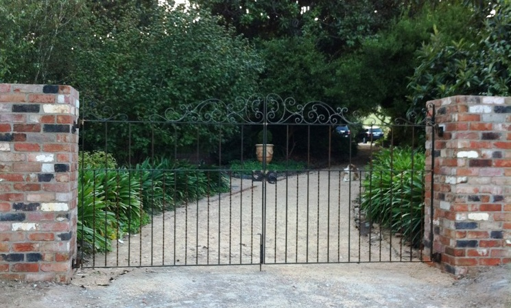 Wrought iron country estate gates needn't be expensive. Sometimes simple wrought iron designs are better than something over complicated.