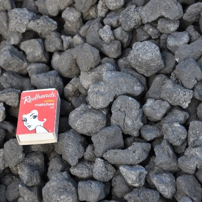 Small diameter blacksmithing coke is available from Farmweld in cartons or large bulk bags. Coke puts out a lot of heat with little smoke.