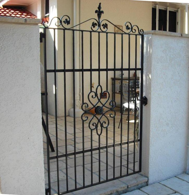This wrought iron courtyard gate with wrought iron centre motif was made for a French Provincial style courtyard.