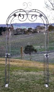 Ornate wrought iron garden arch