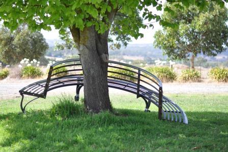 Every wondered how a tree bench fits around a tree? It's made in two halves and bolts together.