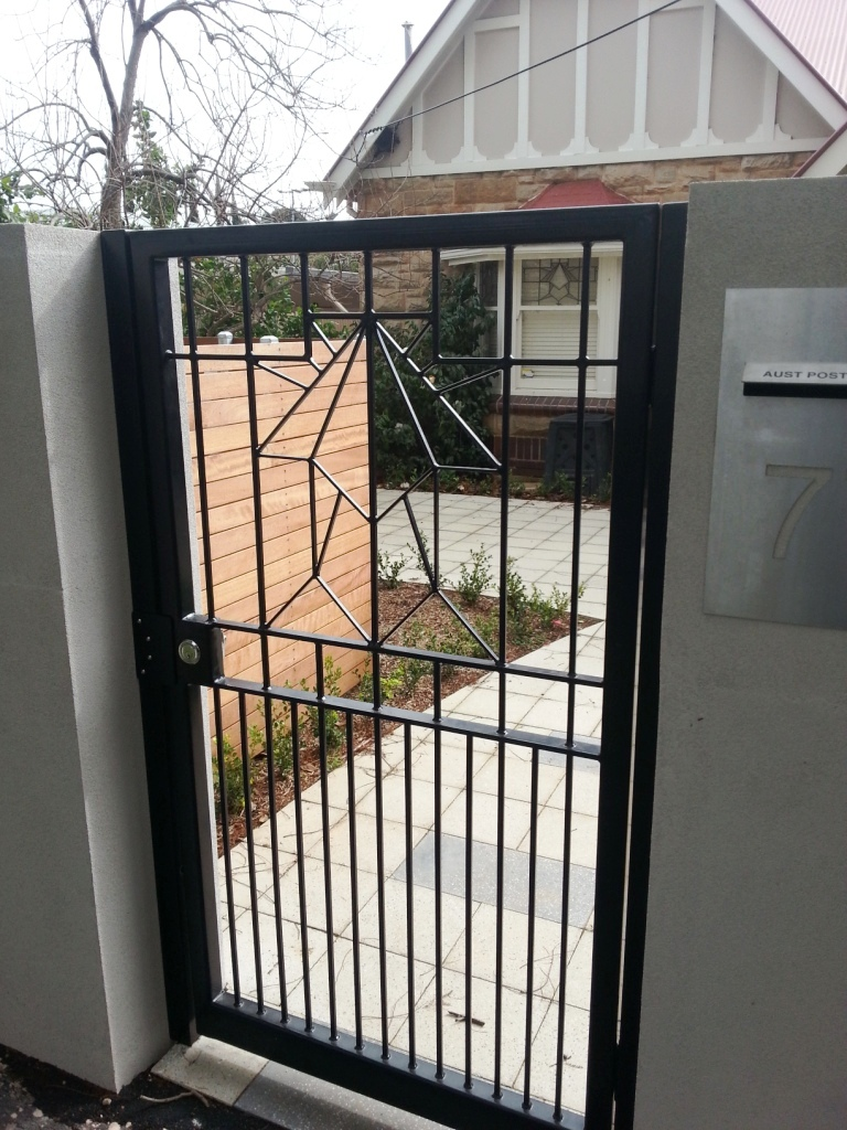 Photo of an Art Deco personal access gate designed to complement the stain glass windows of a Bungalow home in Adelaide, South Australia