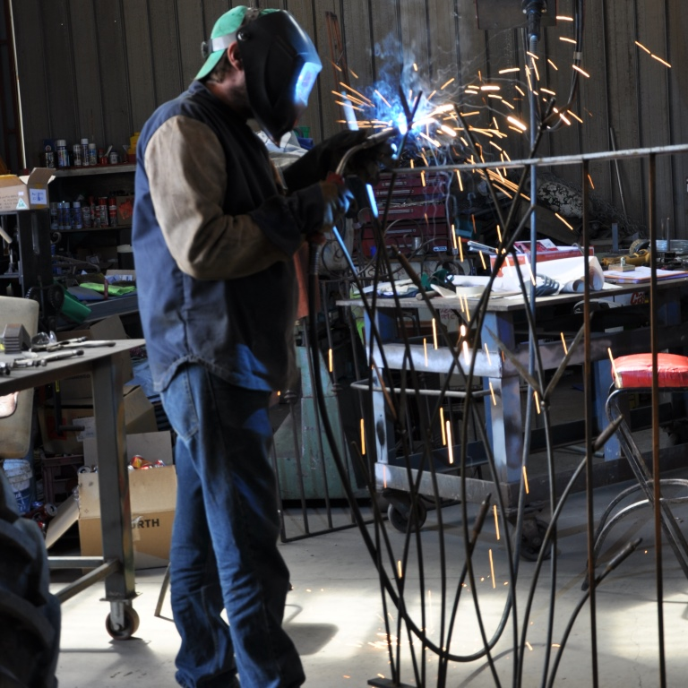 Every leaf on these steel fence panels by Farmweld are welded in place carefully, to bring them to life and give them a sculptural look.