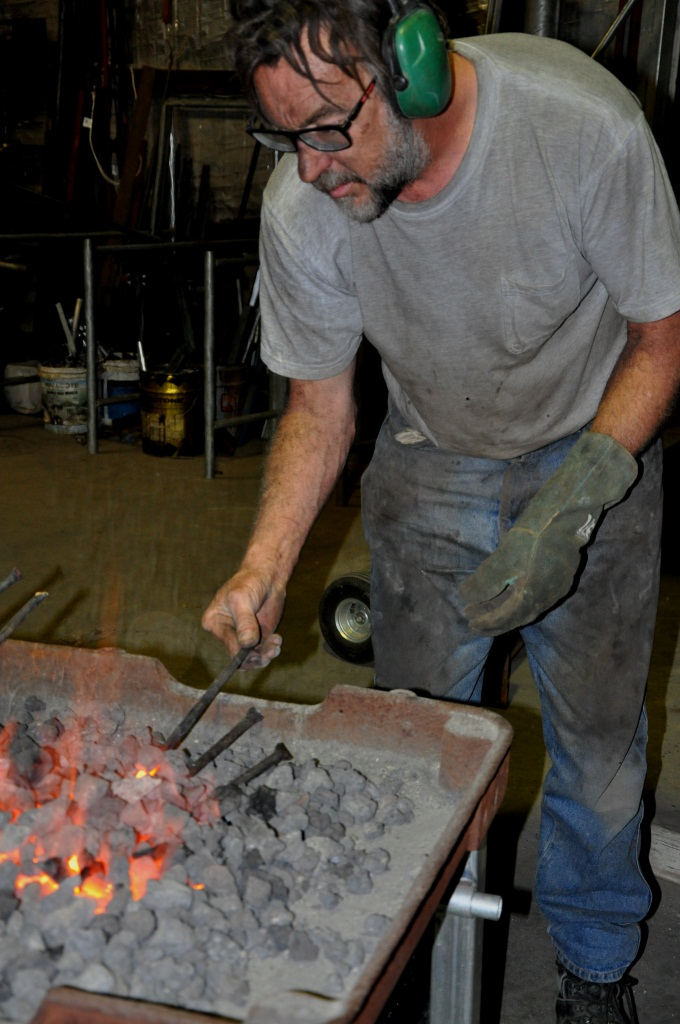 Adelaide Hills blacksmith Andrew Hood needs to work quickly when several pieces of steel are heating up in his forge.