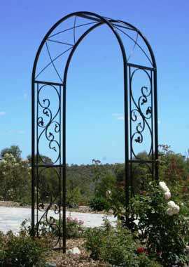 Create a focal point using an ornamental wrought iron garden arch. This custom design at Brigadoon WA is 1200mm wide x 500mm deep.