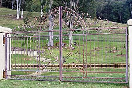 Grand wrought iron driveway gates